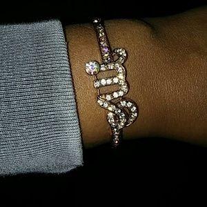 Goldtone bracelet with me cz stones